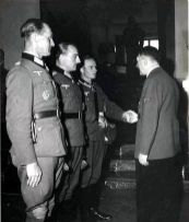 Werner Mummert , Lieutenant d. R. Josef Schneider and a wounded Johann Schwerdfeger (shaking hands with the Führer) at the Eichenlaub ceremony on the Berghof (Obersalzberg) in the late spring / early summer of 1944.