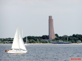 Laboe Tower seen from water with submarine museum U-995 at beach.