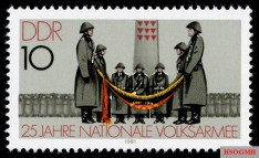 A stamp celebrating 25 years of the NVA. In the background stands a memorial commemorating those who perished in the former Nazi Sachsenhausen Concentration Camp.