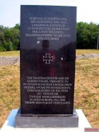 """Commemorative plaque for the Dutch volunteers of the Wehrmacht and Waffen-SS on the grounds of the Sinimägede Museum in Vaivara near Narva, Estonia. Inscription: """"In memory of the fallen , missing and prisoners of war . Perished Dutch combat soldiers, nurses and aid volunteers who have faithfully fulfilled in Eastern Europe during World War II 1941-1945 their duty"""" Also on the exhibition grounds memorials and graves for and by soldiers from Estonia , Norway , Sweden , Denmark , Germany , Banat , Transylvania ,Flanders and Wallonia , which participated in the """"Battle of the Blue Mountains"""" in Estonia in 1944."""