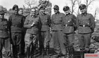 """Officers of the 4th SS Volunteer Tank Brigade """"Nederland"""", spring 1944 on the Eastern Front; from left to right: SS Hauptsturmfuhrer Lothar Hofer (Commander II. Artillery Division), SS-Hauptsturmführer Carl-Heinz Frühauf (Commander II. Battalion / SS Panzergrenadier-Regiment 49 """"de Ruyter""""), SS-Sturmbannführer Dietrich Ziemssen ( Ia the 4th SS volunteer tank grenadier brigade """"Nederland""""), SS Brigadefuhrer and Major General of the Waffen-SS Jürgen Wagner (commander 4th SS volunteer Panzergrenadier Brigade """"Nederland""""), SS-Hauptsturmführer Christian Steenholdt-Schütt (IIa 4th SS Volunteer Panzergrenadier Brigade """"Nederland""""), SS-HauptsturmführerHans Meyer (Commander I. Battalion / SS Panzer Grenadier Regiment 49 """"de Ruyter""""), SS-Obersturmbannführer Hans Collani (Commander SS Panzer Grenadier Regiment 49 """"de Ruyter""""), SS-Hauptsturmführer Wilhelm Schlüter (Commander I. Artillery Department) and SS-Hauptsturmführer Günter Wanhöfer (Commander Pioneer Battalion)."""