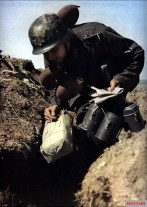 Eastern Front. A German courier delivering mail and rations to combat troops in the trenches.