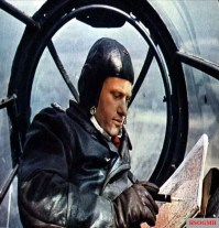 The Beobachter – the literal translation of the term is 'observer' – checking his position on the map. He is inside the glazed nose section of a Heinkel He 111.
