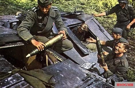 The Heeres-Sturmartillerie crew Replenished their 75mm shells ammunition to their Sturmgeschütz III (StuG III) from a parked Sd.Kfz. 252 leichte Gepanzerte Munitionskraftwagen.