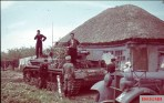 Panzerkampfwagen IV Ausf.F1 has established itself in front of a thatched house in a village on the Kalmyk Steppe, asking for water to the locals, September 1942.