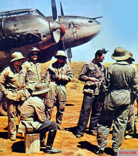 "Luftwaffe aircrew from Zerstörergeschwader 26 (ZG 26) ""Horst Wessel"" wearing tropenhelm (tropical/sun helmet) in the makeshift airfield of North African desert, 1942."