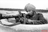 A soldier of the Indian Legion with an MG 34 in Bordeaux, in March 1944.