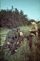A German mortar crew prepares to fire the 8cm schwere Granatwerfer 34 during training.