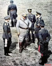 "From left to right: unidentified Luftwaffe general, Reichsmarschall Hermann Göring (Oberbefehlshaber der Luftwaffe), General der Flieger Gustav Kastner-Kirdorf (Chef des Luftwaffen-Personalamt), and General der Fallschirmtruppe Kurt Student (Kommandierender General der Fallschirmjäger). The picture was taken in May 1942 when Göring visited the Truppenübungsplatz (Training Area) Gross-Born in Pomerania and inspected 2,000 Luftwaffe officers and NCOs for the event of ""Kriegsalltag im Deutschen Reich""."