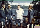 From left to right: Generaloberst Alfred Keller (Chef Luftflotte 1 und Luftwaffenbefehlshaber Mitte), Generaloberst Hans Jeschonnek (Chef des Generalstabes der Luftwaffe), Reichsmarschall Hermann Göring (Oberbefehlshaber der Luftwaffe), Generaloberst Alexander Löhr (Chef Luftflotte 4), and Generalfeldmarschall Albert Kesselring (blocked by Löhr, Chef Luftflotte 2). The picture was taken by Kriegsberichter Eitel Lange in the terrace of Göring's country residence of Carinhall (north-east of Berlin), 6 July 1941. In the background we can see a beautiful lake named Großdöllner See and Schorfheide forest.