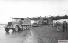 German reinforcements; a Sd.Kfz. 8 half-track and a tractor pull transport from a Messerschmitt Me 323 Gigant.