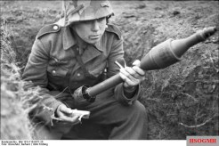 A German soldier handling a RPzB. Gr. 4322 HEAT rocket used with the Panzerschreck.