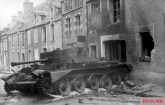 A British Cromwell observation post tank on Villers-Bocage's main street; one of more than a dozen vehicles destroyed by Michael Wittmann. This tank was commanded by Captain Paddy Victory of the 5th Royal Horse Artillery.