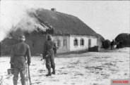 Waffen-SS men near a burning house, Kharkov, February 1943.