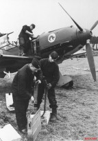 Aircraft of 8./JG 51 being armed.