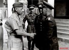 From left to right: Generalmajor (Luftwaffe) Stefan Fröhlich (Fliegerführer Afrika), unidentified Italian officer, Generalmajor Alfred Gause (Chef des Generalstabes Panzergruppe Afrika), and General der Panzertruppe Erwin Rommel (Kommandierender General Panzergruppe Afrika). The picture was taken between September-November 1941.