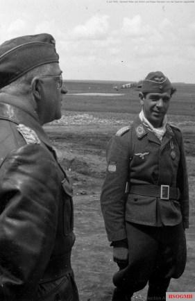 """2 July 1942: General der Flieger Robert Ritter von Greim (Oberbefehl über das Luftwaffenkommando Ost) greeted by Major Julio Salvador Díaz-Benjumea (Staffelkapitän 15.[Spanische]Staffel / Jagdgeschwader 51) in his visit to the 15.(Spanische)Staffel base at Orel, Soviet Union. Behind Greim standing Hauptmann Hartmann Grasser (Gruppenkommandeur II.Gruppe / Jagdgeschwader 51 """"Mölders"""")."""