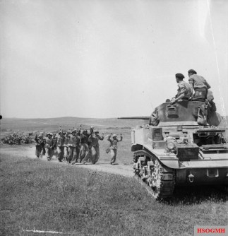 German troops surrender to British crew of a Stuart tank near Frendj, 6 May 1943.