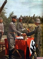 Army officer shake hands with his soldier in the latter's proxy marriage wedding ceremony. Picture allegedly taken in the outskirts of Stalingrad, summer 1942.