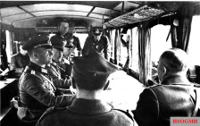 At 12:45 hours appeared, led by the Chief of Staff of the Polish First Army Corps, General Tadeusz Kutrzeba (right, back to the camera) accompanied by the Chief of Staff of the Commander of the Garrison of Warsaw, Colonel Aleksander Tadeusz Praglowski (2nd from right). In the command vehicle of 8 AOK (Armeeoberkommando) were established the conditions for a 24-hour truce, in order to begin negotiations for the surrender of the fortress. The beginning of this is set for September 28, 1939 at 09:00 hours. On behalf of German forces was General der Infanterie Johannes Blaskowitz (Oberbefehlshaber 8. Armee), who sit in the middle. The negotiation was held inside the Omnibus Opel Blitz Typ 3.6-47 2.5-ton, 4x2.