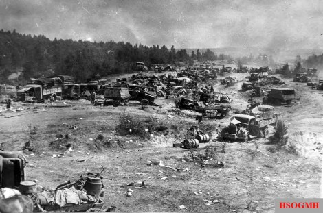 Abandoned vehicles of the German 9th Army at a road near Bobruisk.