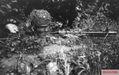 A Fallschirmjäger firing the early FG 42 in June 1944.