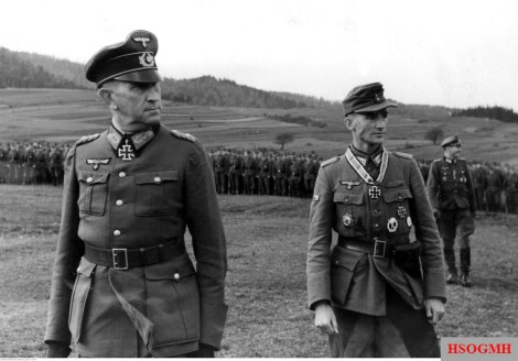 From left to right: Generalleutnant Hans Piekenbrock and Major Klaus Sinram pass before a number of soldiers in the Ritterkreuz award ceremony for Sinram, 1 November 1944.