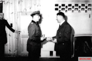 Kurt Meyer, commander of the Leibstandarte's reconnaissance battalion, receiving the Oak Leaves to the Knight's Cross from Adolf Hitler on 25 February 1943 at the Führerhauptquartier Werwolf in Vinnytsia.