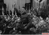 The Liberator of Mussolini', SS-Sturmbannführer der Reserve Dipl.-Ing. Otto Skorzeny, saluted to Reichsminister Joseph Goebbels - as a speaker in the podium - after being introduced to the audience, during the Thanksgiving (Erntedanktag) celebration at Berliner Sportspalast on 3 October 1943.