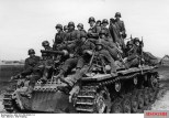 Panzer III carrying infantry in March, 1942.