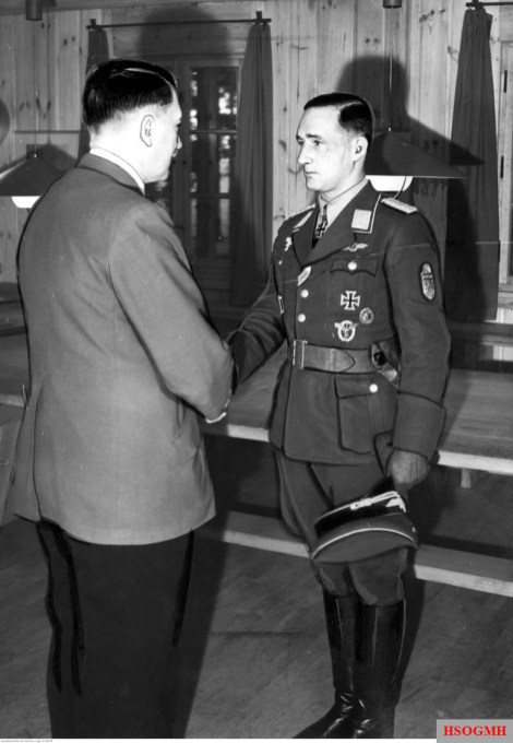 23 September 1942 in Führerhauptquartier Vinnitsa, Ukraine: Major Gordon Gollob receives the highest German award from Adolf Hitler as the third soldier of the Wehrmacht: Ritterkreuz des Eisernen Kreuzes mit Eichenlaub, Schwertern und Brillanten (Knight's Cross of the Iron Crosses with Oak Leaves, Swords and Diamonds).