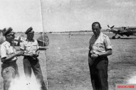 "German Luftwaffe ace Oskar-Heinrich (""Heinz) Bär (right) the Stab I./JG 77. The photo was probably taken at Comiso, Italy, in July 1942."