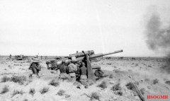 8.8 cm (3 in) Flak 18 guns fire upon British armour.
