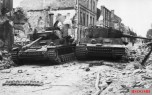 Knocked out Panzer IV and a Tiger I of the Panzer Lehr division at Villers-Bocage.