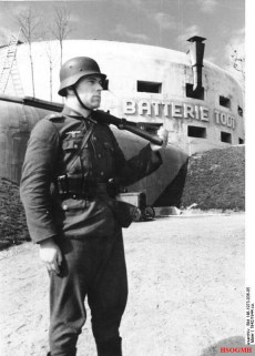 German soldier in front of part of the OT-built Atlantic Wall at Cap Gris Nez, France.