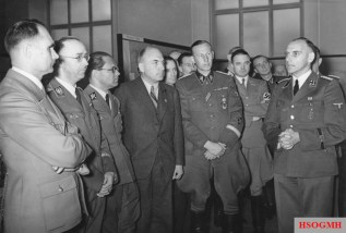 From left: Rudolf Hess, Heinrich Himmler, Philipp Bouhler, Fritz Todt and Reinhard Heydrich listen to Konrad Meyer at a Generalplan Ost exhibition in Berlin, 20 March 1941.