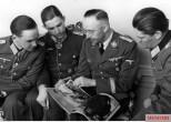 Reichsführer-SS Heinrich Himmler and the Ritterkreuzträger from Panzertruppen: This picture was taken on April 1942 by Bildberichter Haine and showing, from left to right: Hauptmann Artur Wollschlaeger (Ritterkreuz on 12 January 1942 as Oberleutnant and Chef 2.Kompanie / I.Abteilung / Panzer-Regiment 35 / 4.Panzer-Division), Hauptmann Hans-Günther Bethke (Ritterkreuz on 4 September 1940 as Oberleutnant and Führer 5.Kompanie / II.Abteilung / Panzer-Regiment 11 / 6.Panzer-Division), Heinrich Himmler (Reichsführer-SS und Chef der deutschen Polizei), and Hauptmann Wilhelm Renner (Ritterkreuz on 5 August 1940 as Oberleutnant and Chef 8.Kompanie / II.Bataillon / Schützen-Regiment 2 / 2.Panzer-Division).