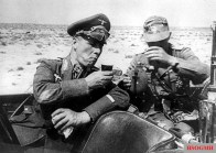 Erwin Rommel at a drinking break during a desert trip.
