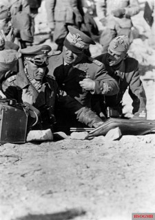 Rommel in the African campaign in tactical conversation with two Italian generals.