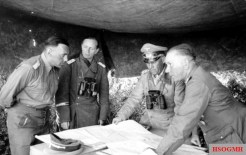 """Briefing in preparation for the company """"Theseus"""" at Rommel headquarters in April 1942. From left to right: Lieutenant Colonel i. G. Fritz Bayerlein , Ia of the German Afrika Korps, Lieutenant Colonel i. G. Siegfried Westphal , Ia of XXVII. Army Corps, Colonel-General Erwin Rommel, Commander-in-Chief of the Panzer Army """"Africa"""" and Lieutenant General Walther Nehring , Commanding General of the German Afrika Korps."""