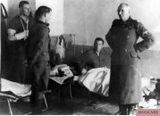 "14 October 1943: SS-Brigadefuhrer und Generalmajor der Waffen-SS Herbert Otto Gille (Kommandeur 5. SS-Panzer-Division ""Wiking""), at right, visited the Feldlazarett (Field Hospital) and decorates SS-Obersturmführer Hans Drexel (stellvertreter Führer II.Bataillon / SS-Panzergrenadier-Regiment ""Westland"" / 5.SS-Panzer-Division ""Wiking""), second from left, with the Ritterkreuz des Eisernen Kreuzes (Knight's Cross of the Iron Crosses). The picture was taken by SS-Kriegsberichter Koch."