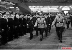 "Hitlerjugend demonstration under the banner of ""Die Ritterkreuzträger der Kriegsmarine Rede an die Hitlerjugend"" (The Knight's Cross Recipients of the German Navy Speech to the Hitler Youth) at the Berlin Sportpalast, 16 June 1943. Hitlerjugend leader, Reichsjugendführer Artur Axmann, arrives to the venue with the Ritterkreuzträger."
