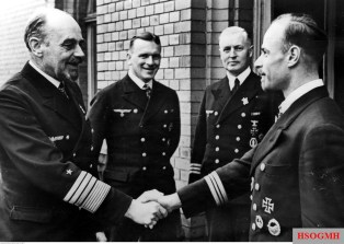 November 1942: Generaladmiral Rolf Carls congratulates Kapitänleutnant Siegfried Strelow for his award of the Ritterkreuz des Eisernen Kreuzes, which he received on 27 October 1942 as Kommandant of U-435. Visible second from left is Eichenlaubträger Kapitänleutnant Herbert Emil Schultze.