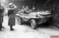 German officers in a Schwimmwagen in France in 1944.
