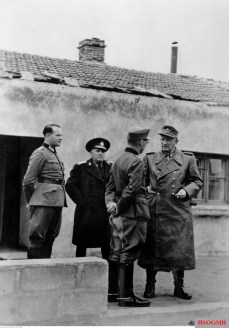 German and Romanian Generals after leaving the command post of the 17. Armee in Stanowska, Kerch Peninsula/Crimea, Soviet Union, January 1944. From left to right: unidentified, General de divizie Corneliu Teodorini (Commander of Romanian 6th Cavalry Division / V. Armeekorps / 17.Armee), General der Infanterie Karl Allmendinger (Kommandierender General V.Armeekorps / 17.Armee), and Generaloberst Erwin Jaenecke (Oberbefehlshaber 17. Armee).