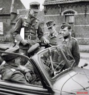Lieutenant General Plocher (in the passenger seat) receives reports from a subordinate on 19 September 1944 during Operation Market Garden.