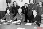 Surrender of the Wehrmacht in Berlin-Karlshorst on May 8, 1945; Sitting from the left: Hans-Jürgen Stumpff (left), Wilhelm Keitel (center) and Hans-Georg von Friedeburg (right) signing the unconditional surrender of the Wehrmacht in the Pionierschule I in Karlshorst on May 9, 1945. Standing behind: Vice Admiral Leopold Bürkner (between Stumpff and Keitel), Corvette Captain Otto Salman (looking back), and Lieutenant Colonel Karl Böhm-Tettelbach.