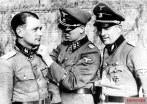 Kurt Meyer gives SS-Obersturmführer Hermann Weiser of the 2nd Panzeraufklärer Company the Knight's Cross while division Doctor Hermann Besuden acts as a witness.