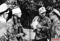 Briefing with Kurt Meyer (right), Bernhard Krause (center) and Max Wünsche on the invasion front, 1944.