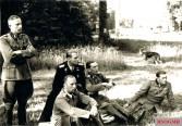 "Officers of the SS at the birthday party for SS Brigadefuhrer and Major General of the Waffen-SS Fritz Witt on 27 May 1944 in Tillières-sur-Avre ( France ); v. l. n. r .: SS-Standartenfuhrer med. Hermann Besuden (corps doctor I SS Panzer Corps ""Leibstandarte"" ), SS-Obersturmbannführer Wilhelm Mohnke (commander SS Panzer Grenadier Regiment 26), SS-Obersturmbannführer Max Wünsche (commander SS Panzer Regiment 12), SS-Standartenführer Kurt Meyer (Commander SS Panzer Grenadier Regiment 25) and SS Sturmbannführer Gerhard ""Gerd"" Bremer (Commander SS Panzer Reconnaissance Division 12)."
